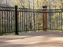 wrought iron deck railings and stacked stone to match fireplace