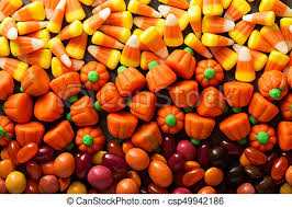 pumpkin candy corn candy corn and pumpkin background overhead pictures