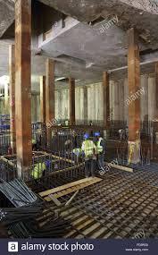 construction of a reinforced concrete basement floor slab on a