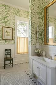 cheery bathroom with wallpaper and white subway wainscoting