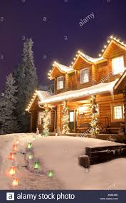Home Decoration With Lights Log Home Decorated With Christmas Lights And Luminaries On The