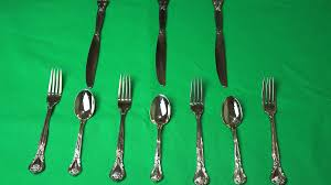 beautiful arrangement of fork and spoon on a black tray which is