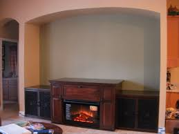 custom made maple entertainment center with electric fireplace by