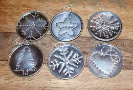 lightly enchanted recycled tin christmas decorations