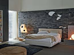 Modern Brick Wall by Bedrooms With Exposed Brick Walls