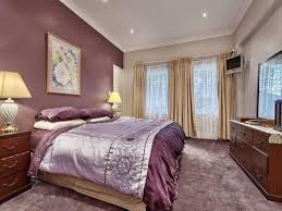 satin purple comforter and beige wall color for romantic bedroom