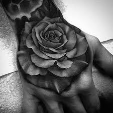 beautiful black and gray rose and skull tattoos by bobby loveridge