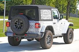 2018 jeep wrangler spy shots spied pics jl wrangler 2 door shows off the new soft top