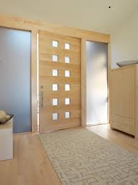 simple design of apartment entryway with brown wooden floor also