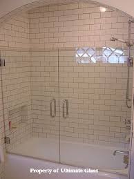 subway tiles and frameless glass enclosed tub gorgeous
