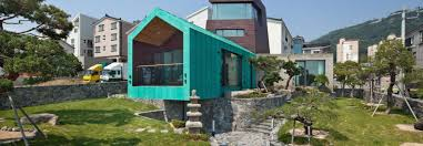this bright teal tiny house features an observation tower for