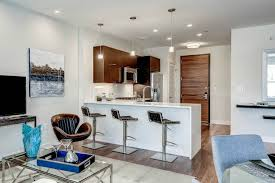 furniture beautiful kitchen island and waterfall countertop with beautiful kitchen island and waterfall countertop with barstools with kitchen cabinets also pendant lighting and swivel chair with coffee table plus area