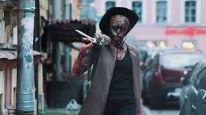 halloween city game cosplayer in scary halloween costume of zombie in cowboy hat from