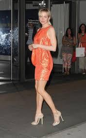 renee zellweger wearing a short dress has gorgeous legs in high