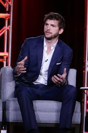 ashton kutcher wears boss tailoring to introduce his new show the