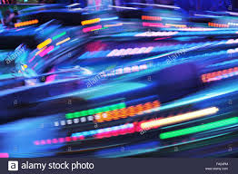 fairground funfair ride moving fast fair lights colours of