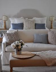 i like the pillow arrangement on the bed and the cozy loveseat at