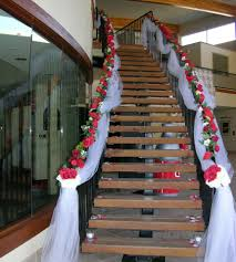 stairway decorated with white tulle and red silk roses wedding