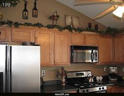 Home Decoration Themes Brilliant Kitchen Decorating Themes Tuscan Above Cabinet Ideas