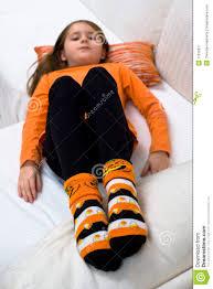 halloween knee socks halloween pumpkin socks sofa royalty free stock photography