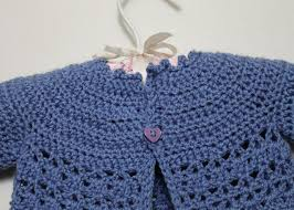 crochet baby sweater pattern crocheted baby cardigan and matching flower brooch for