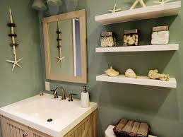 beach themed bathroom with seashell accessories and floating
