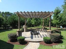 contemporary patio with exterior brick floors u0026 fence in fuquay