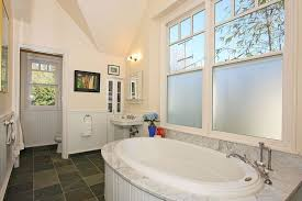 traditional 3 4 bathroom with wainscoting drop in bathtub in
