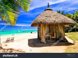 relaxing tropical holidays scenery beach bungalow stock photo