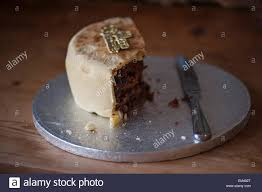 half eaten marzipan christmas cake with crumbs on a silver cake