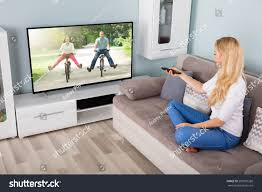 Technology At Home Young Woman Sitting On Couch Watching Stock Photo 582987268