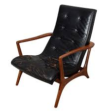 protege chaise sculptural solid walnut abd leather lounge chair leather lounge