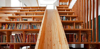 library staircase with a slide