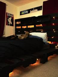 bed frame with lights my finished pallet bed frame with string lights and shelves home