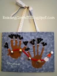 santa and reindeer handprint craft from reading confetti homemade