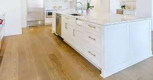 white kitchen cabinets with oak floors engineered plainsawn white oak floor vermont plank flooring