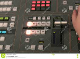 Studio Mixer Desk by Tv Editor Working With Audio Video Mixer In A Television Broadca
