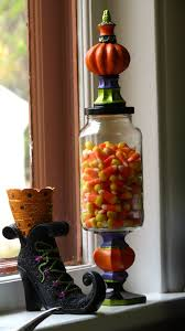 a halloween candy jar created from a re purposed spaghetti sauce
