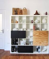 our ikea kallax unit used for kitchen storage for the home