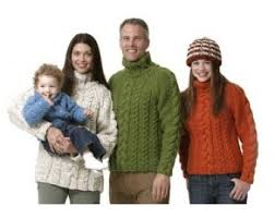 family of cabled sweaters knit brand yarn
