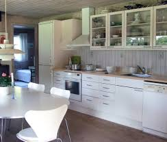 white beadboard kitchen kitchen traditional with glass panel