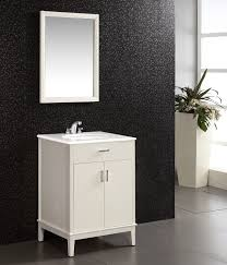 bathroom dark gray cabinet with brown marble countertop and sink