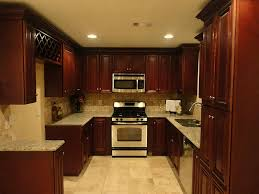 amazing dark brown color mahogany wood kitchen cabinets featuring