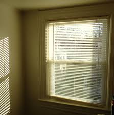 file pattern of light on wall by sun through blinds plus window