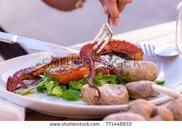 cuisine delacroix grilled octopus served corn salad papas stock photo 771448933