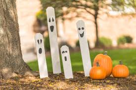 diy halloween decorations glow in the dark ghost fence posts