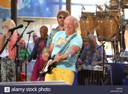 Jimmy Buffet Casino by Jimmy Buffett Singer Jimmy Buffett Wearing Flip Flops And Yellow