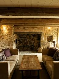 living room guernsey traditional cosy living space with original restored fireplace in