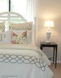 What Is A Coverlet Used For A Dash Of Red And A Mirror Made Of Oyster Shells Complete This