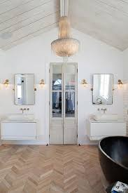 white floating sink vanity with brass pivot mirror contemporary
